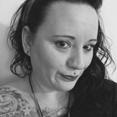 Getting Pierced | Electric Chair Tattoo: Flint, MI